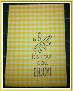 I chose a pretty yellow gingham cardstock and stamp the first image.